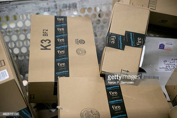 Amazoncom packages await shipment at the Indianapolis Mail Processing Annex December 15 2014 in Indianapolis Indiana The US Postal Service predicts...