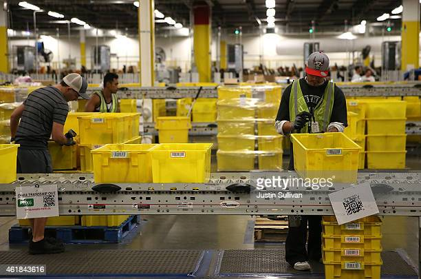 Amazoncom workers pack orders at an Amazon fulfillment center on January 20 2015 in Tracy California Amazon officially opened its new 12 million...