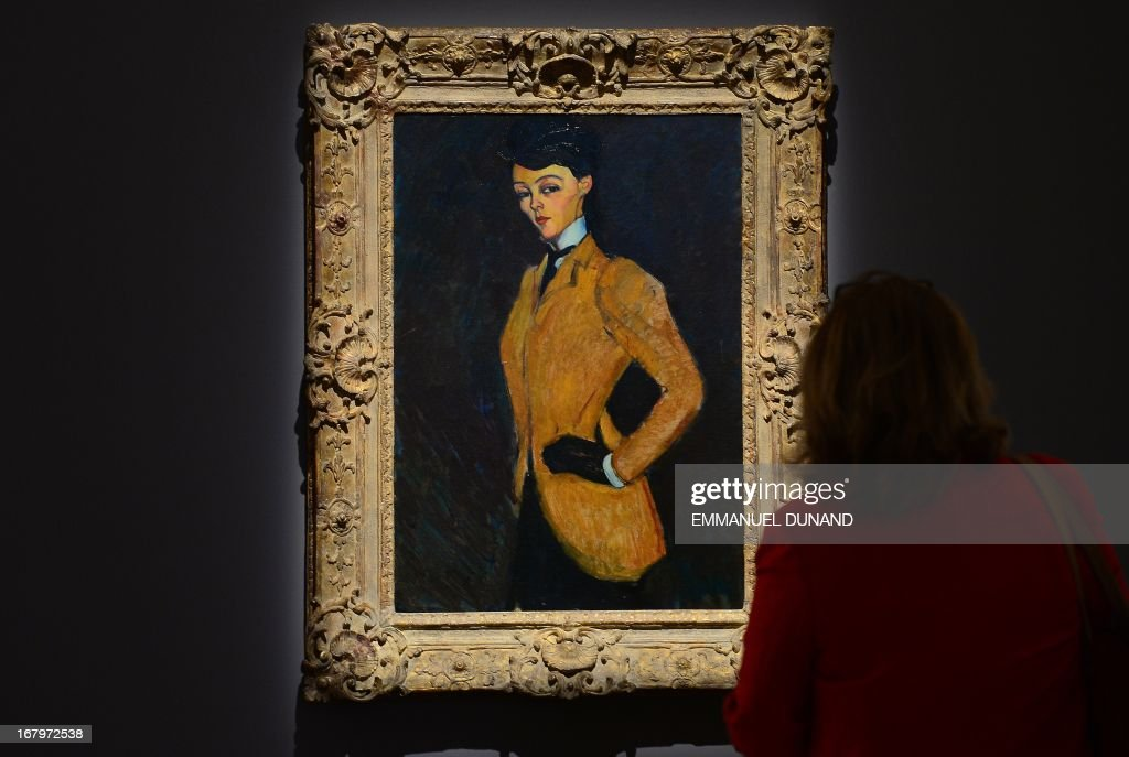'L'Amazone' by Amedeo Modigliani is on display during a preview of Sotheby's Impressionist and Modern Art sales in New York on May 3, 2013. Sotheby's is scheduled to hold its Impressionist and Modern Art sales May 7. AFP PHOTO/Emmanuel Dunand ++RESTRICTED