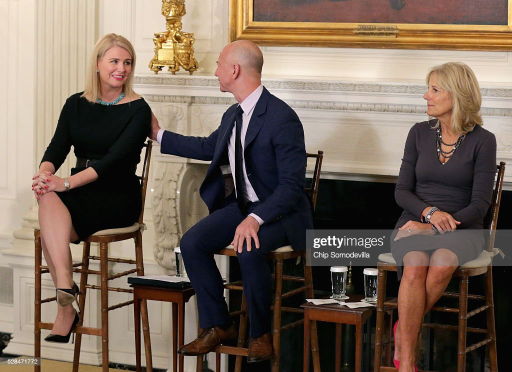 Amazon's head of military outreach Kathleen Carroll, Amazon founder and CEO <a gi-track='captionPersonalityLinkClicked' href=/galleries/search?phrase=Jeff+Bezos&family=editorial&specificpeople=217573 ng-click='$event.stopPropagation()'>Jeff Bezos</a> and Dr. <a gi-track='captionPersonalityLinkClicked' href=/galleries/search?phrase=Jill+Biden&family=editorial&specificpeople=997040 ng-click='$event.stopPropagation()'>Jill Biden</a> participate in an event announcing commitments from more than 50 companies that have pledged to hire and train veterans and military spouses in the State Dining Room at the White House May 5, 2016 in Washington, DC. On the fifth anniversary of Obama and Biden's military hiring initiative Joining Forces, Bezos announced a commitment by his company to hire 25,000 more military veterans in the next five years.