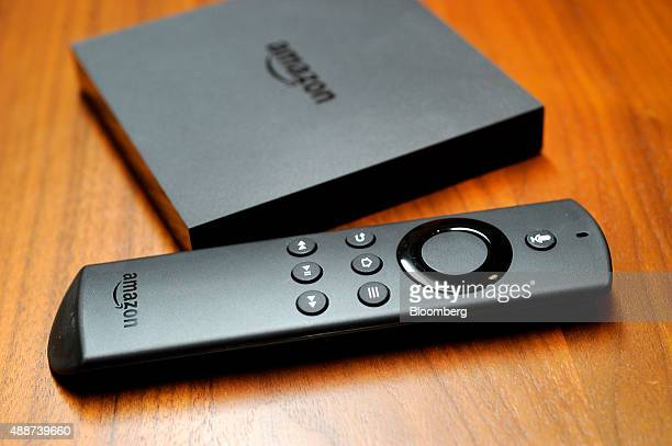 Amazon's new Fire TV unit and Alexa enabled remote control are displayed for a photograph in San Francisco California US on Wednesday Sept 16 2015...