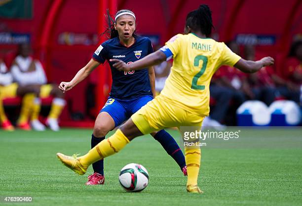 Ambar Torres of Ecuador plays a ball through the legs of Christine Manie of Cameroon during the FIFA Women's World Cup Canada 2015 Group C match...