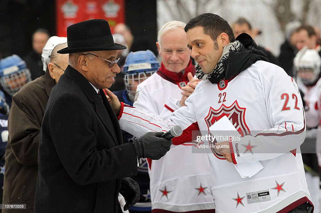 NHL ambassador and former NHL player Willie O'Ree greets TV and radio personality <a gi-track='captionPersonalityLinkClicked' href=/galleries/search?phrase=George+Stroumboulopoulos&family=editorial&specificpeople=4334058 ng-click='$event.stopPropagation()'>George Stroumboulopoulos</a> at the 2012 NHL All-Star Game - H.E.R.O.S. Community Program Launch at Rideau Hall on January 28, 2012 in Ottawa, Ontario, Canada.