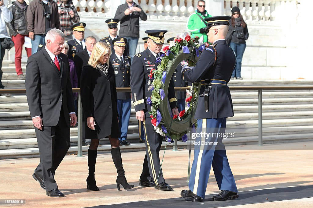 NBA ambassador Bob Delaney, wife Billie Delaney and Major General Jeffrey S. Buchanan place a wreath at the Tomb of the Unkown Soldier at Arlington National Cemetery on November 13, 2013 in Washington, DC.