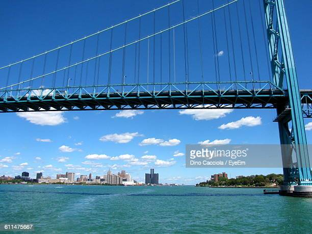 Ambassador Bridge Over Detroit River In City Against Sky