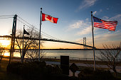 The Ambassador Bridge links Detroit, Michigan, USA with Windsor, Ontario, Canada.  It is one of the busiest trade routes in North America.  This photo depicts the bridge, as seen from Windsor.   The n