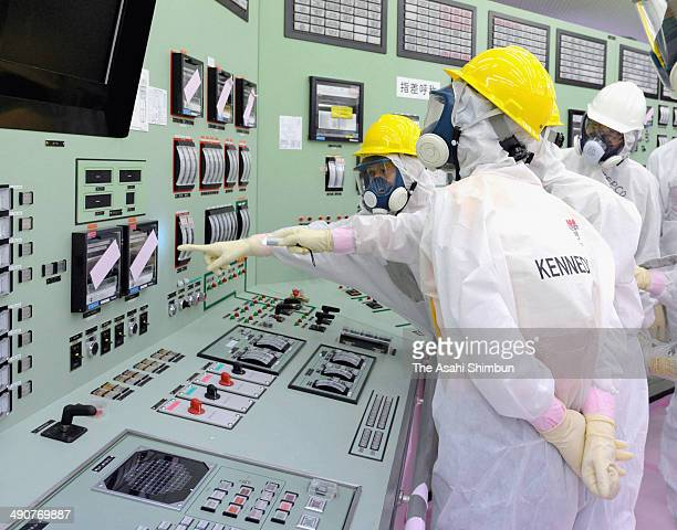 US Ambassador Caroline Kennedy visits inside the central control room for the No 1 and No 2 reactors at the company's Fukushima DaiIchi nuclear power...