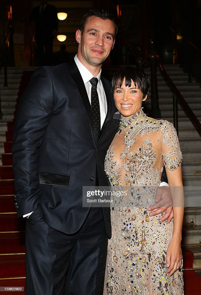 Ambassador, Dannii Minogue and Kris Smith arrive at a function to unveil her favourite Melbourne Sriring Fashion Week 2011 looks at Melbourne Town Hall on September 5, 2011 in Melbourne, Australia.