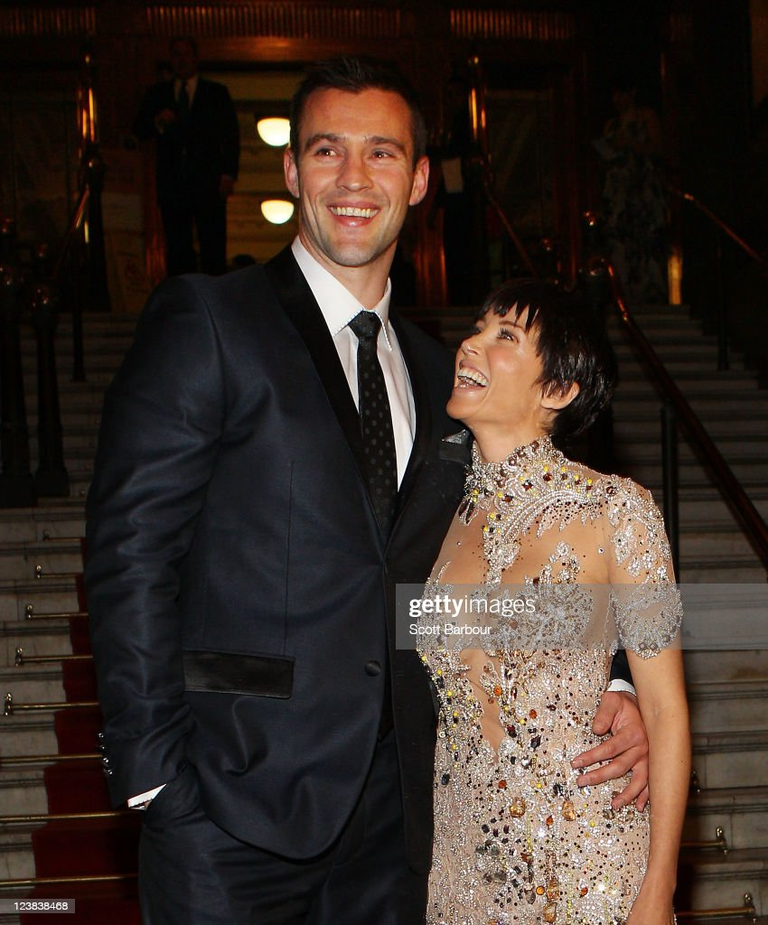 Ambassador, Dannii Minogue and Kris Smith arrive at a function to unveil her favourite Melbourne Spring Fashion Week 2011 looks at Melbourne Town Hall on September 5, 2011 in Melbourne, Australia.