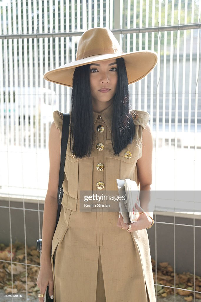 Ambassador for L'Officiel Singapore Yoyo Cao wears a Marc Jacobs dress Charlotte Olympia bag and The Cult of Nine hat on day 6 during Paris Fashion...