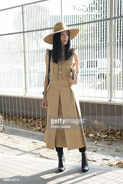 Ambassador for L'Officiel Singapore Yoyo Cao wears a Marc Jacobs dress Charlotte Olympia bag Maison Martin Margiela shoes and The Cult of Nine hat on...