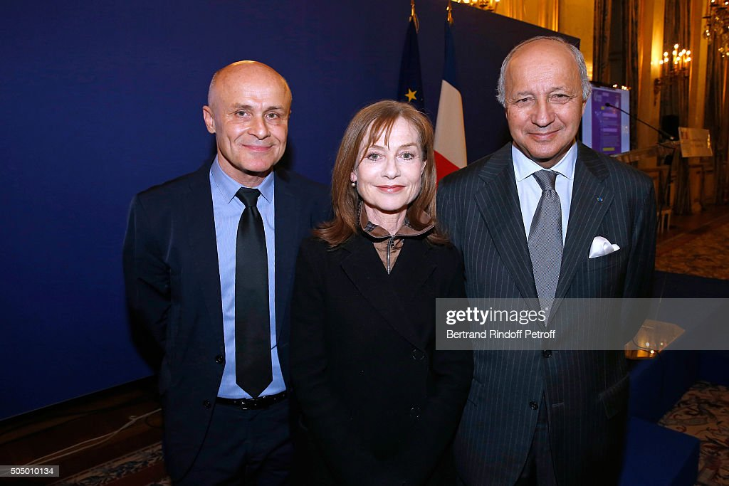 Ambassador for the cultural attractiveness of France, Olivier Poivre d'Arvor, Actress and Sponsor of 'Le Grand Tour', Isabelle Huppert and French Minister of Foreign Affairs, Laurent Fabius launch 'Le Grand Tour' at Quai d'Orsay on January 14, 2016 in Paris, France.