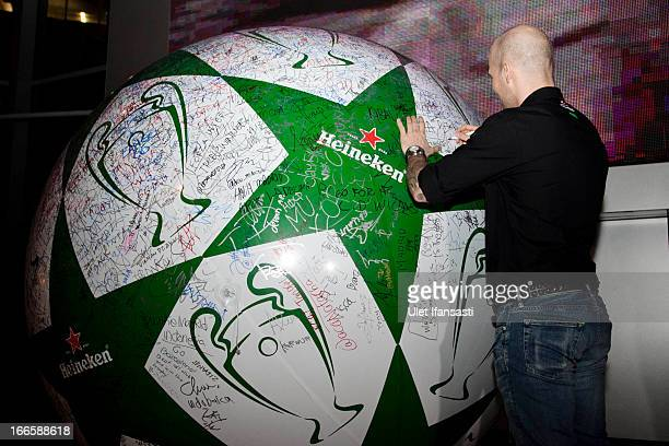 Ambassador Fredrik Ljungberg signature on Heineken giant ball as meet and greet with football fans during the UEFA Champions League Trophy Tour 2013...