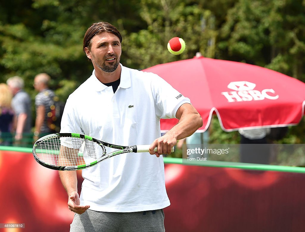 Ambassador Goran Goran Ivanisevic in action at HSBC Court 20 on day one of The Championships Wimbledon England on 23 June 2014