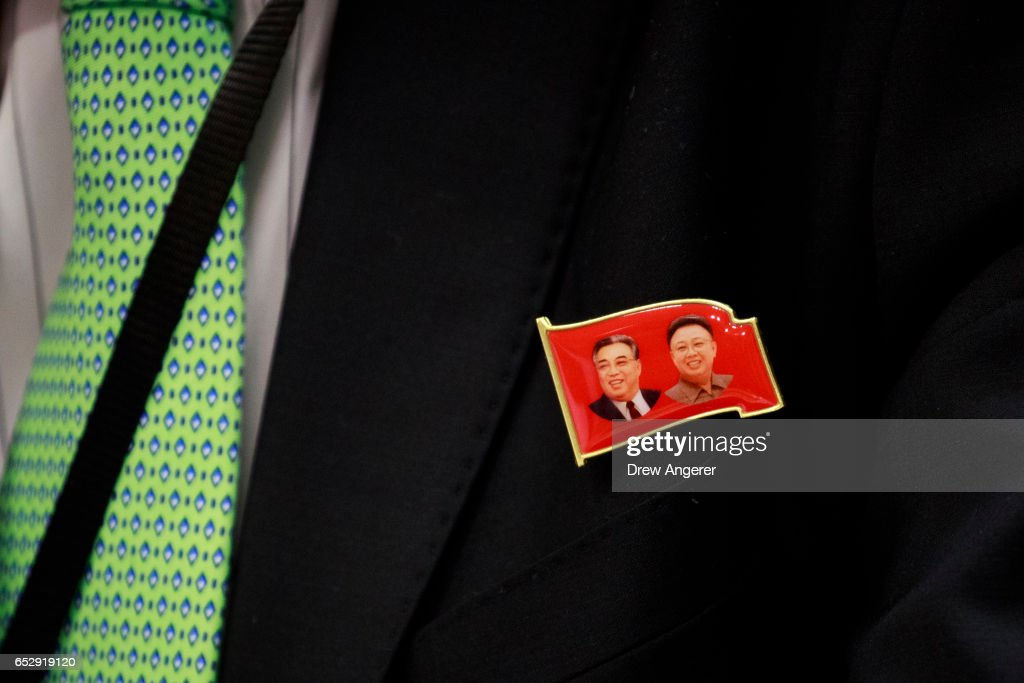 Ambassador Kim In Ryong, Deputy Permanent Representative to the United Nations for the Democratic People's Republic of Korea (North Korea), wears a lapel pin featuring the faces (L to R) of former North Korean leaders Kim Il-sung and Kim Jong-il during a press conference at the United Nations, March 13, 2017 in New York City. Amid fears of their growing ballistic missile programs, global tensions have been rising with North Korea.