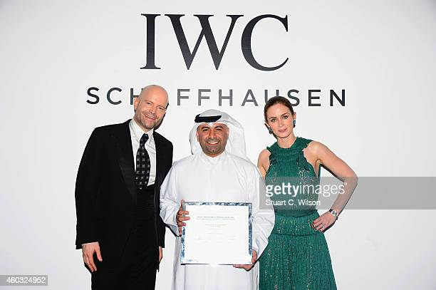 IWC Ambassador Marc Forster Award winner Abdullah Al Boushahri and IWC Ambassador Emily Blunt during the IWC Filmmaker Award Night 2014 at The One...
