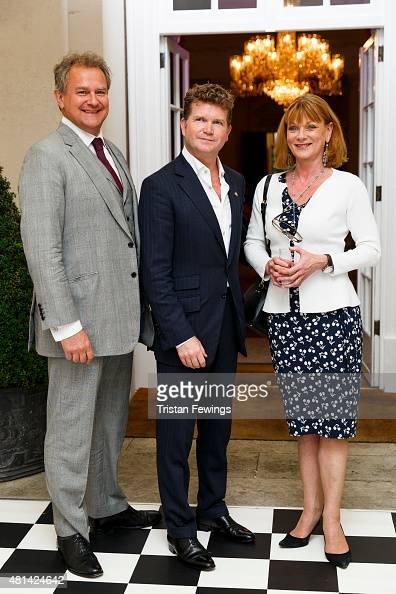 Ambassador Matthew Barzun Hugh Bonneville and Samantha Bond attend a reception hosted by the US Ambassador at his residence at Winfield House to...