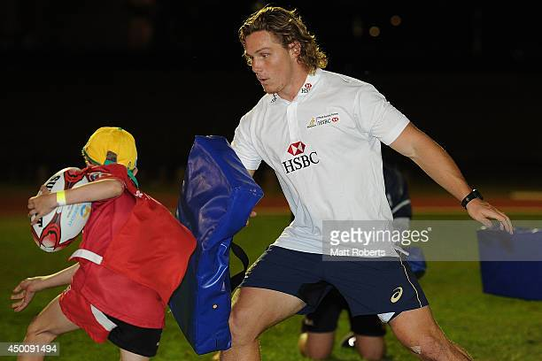 Ambassador Michael Hooper coaching kids during the HSBC Rugby Grass Roots Festival at the University of Queensland Rugby Club on June 5 2014 in...