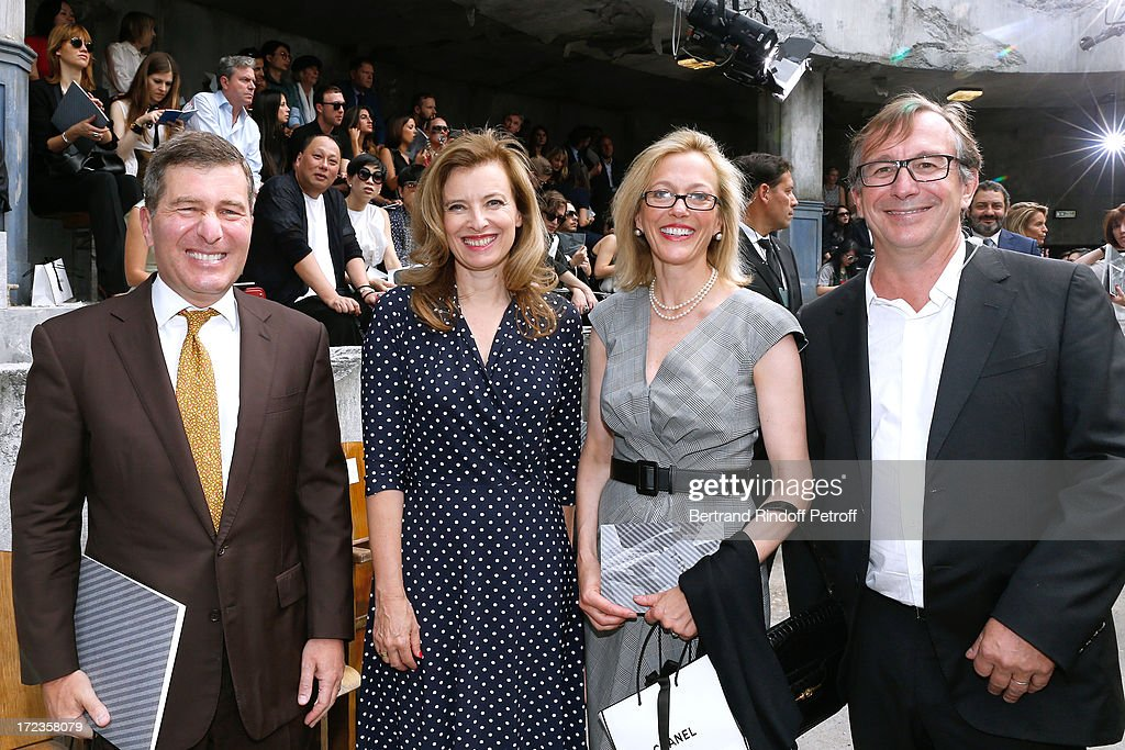 Ambassador of USA <a gi-track='captionPersonalityLinkClicked' href=/galleries/search?phrase=Charles+Rivkin&family=editorial&specificpeople=4891546 ng-click='$event.stopPropagation()'>Charles Rivkin</a> (1st L) and his wife Suzan Tolson (2nd R), <a gi-track='captionPersonalityLinkClicked' href=/galleries/search?phrase=Valerie+Trierweiler&family=editorial&specificpeople=8534231 ng-click='$event.stopPropagation()'>Valerie Trierweiler</a> (2nd L) and general director of Chanel Bruno Pavlovski, attends the Chanel show as part of Paris Fashion Week Haute-Couture Fall/Winter 2013-2014 at Grand Palais on July 2, 2013 in Paris, France.