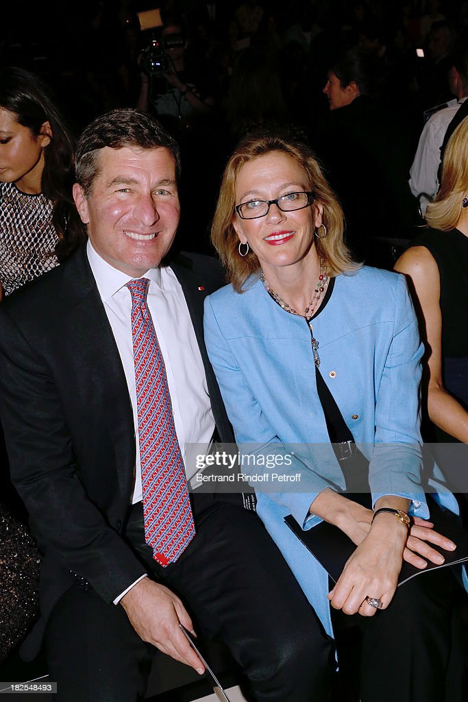 Ambassador of USA <a gi-track='captionPersonalityLinkClicked' href=/galleries/search?phrase=Charles+Rivkin&family=editorial&specificpeople=4891546 ng-click='$event.stopPropagation()'>Charles Rivkin</a> and his wife SuzanTolson attend the Elie Saab show as part of the Paris Fashion Week Womenswear Spring/Summer 2014, held at Espace Ephemere Tuileries on September 30, 2013 in Paris, France.
