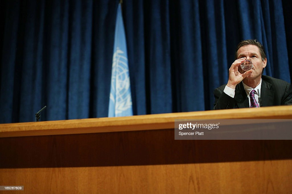 Ambassador Peter Woolcott of Australia, President of the Final UN Conference on the Arms Trade Treaty (ATT), takes a drink of water while speaking at a news conference following the vote on the Arms Trade Treaty at the United Nations (UN) on April 2, 2013 at the UN in New York City. With three countries choosing to vote against it, Iran, North Korea and Syria, the United Nations General Assembly voted overwhelmingly on April 2, to approve the treaty to regulate the global trade in conventional weapons. This is the first-ever such treaty on trade in conventional weapons.