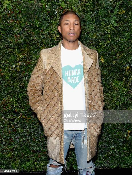 Ambassador Pharrell Williams wearing CHANEL attends the Charles Finch and CHANEL PreOscar Awards Dinner at Madeo Restaurant on February 25 2017 in...