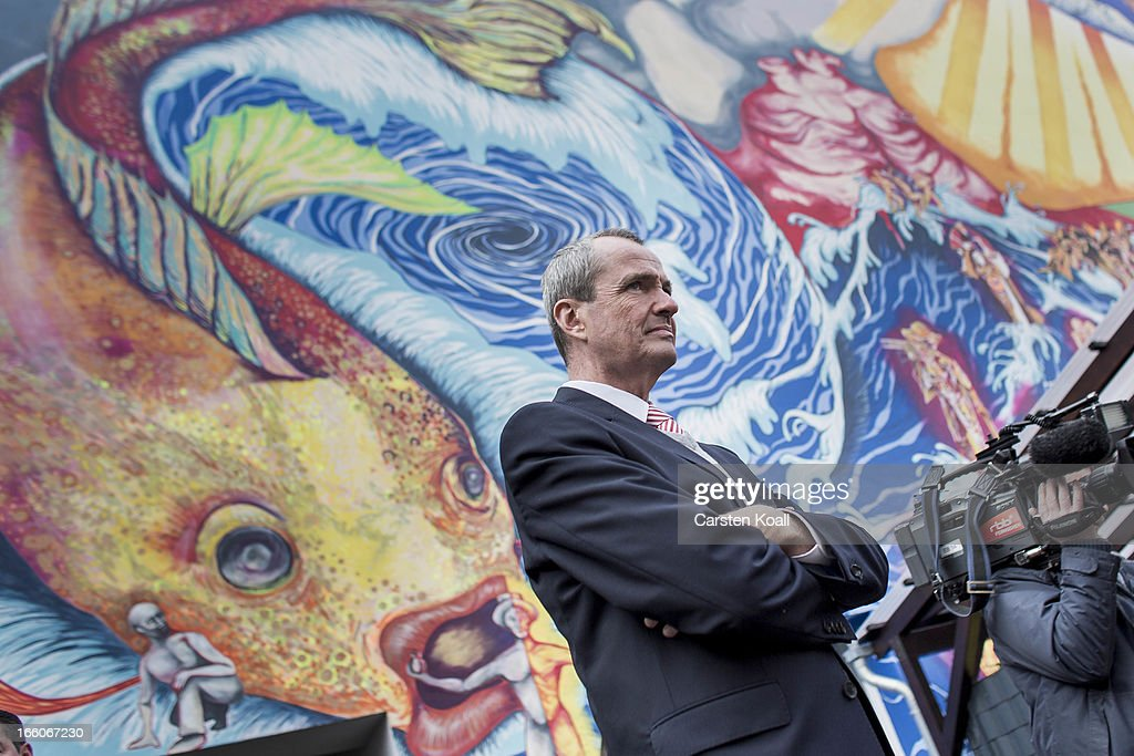 U.S. Ambassador Philipp Murphy stays in front of a over large mural as he visits a Catholic charity housing project home mostly to Roma from Romania and Bulgaria in Harzer Strasse on April 8, 2013, in Berlin, Germany. The Catholic real estate group, called the Aachener Sieldungs- und Wohnungsgesellschaft, bought the complex of buildings with over 100 apartments in 2011, and through the active input of the Roma families living there turned it into a success story of progressive living and immigration policy. The Harzer Strasse facility offers German language classes, urban adaptation and other workshops designed to help the Roma families integrate successfully into life in Germany. Germany, like many countries in western Europe, has experienced a large influx of Roma from Romania and Bulgaria in recent years.