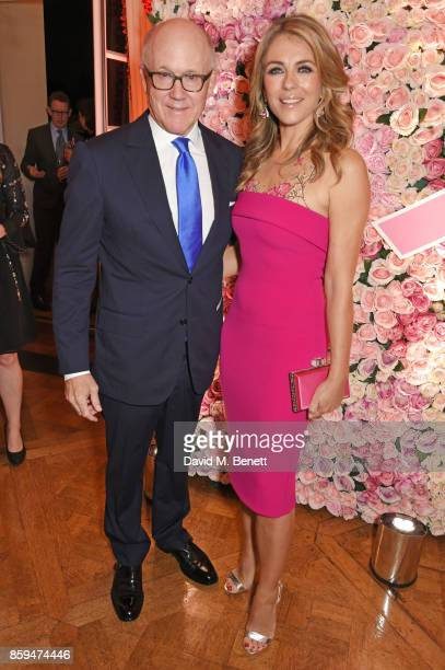 Ambassador Robert W Johnson US Ambassador to the UK and Elizabeth Hurley attend the 25th Anniversary of the Estee Lauder Companies UK's Breast Cancer...