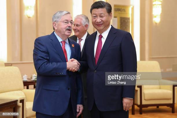 S Ambassador Terry Edward Branstad shakes hands with Chinese President Xi Jinping at the Great Hall of the People on September 30 2017 in Beijing...