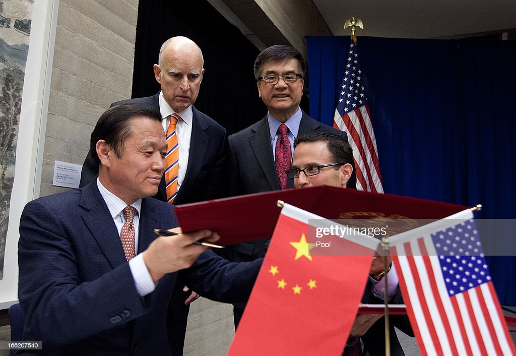 U.S. Ambassador to China <a gi-track='captionPersonalityLinkClicked' href=/galleries/search?phrase=Gary+Locke&family=editorial&specificpeople=1792234 ng-click='$event.stopPropagation()'>Gary Locke</a> (L) and California Governor <a gi-track='captionPersonalityLinkClicked' href=/galleries/search?phrase=Jerry+Brown&family=editorial&specificpeople=217599 ng-click='$event.stopPropagation()'>Jerry Brown</a> (R) witness a memorandum of understanding between U.S. and China during a Trade and Investment reception at the U.S. Embassy on April 10, 2013 in Beijing, China. Brown is in China leading a business delegation and will meet with Chinese government and business leaders to discuss bilateral trade and investment opportunities between China and his state of California.