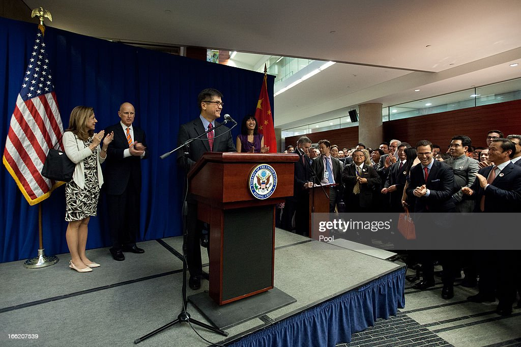 U.S. Ambassador to China <a gi-track='captionPersonalityLinkClicked' href=/galleries/search?phrase=Gary+Locke&family=editorial&specificpeople=1792234 ng-click='$event.stopPropagation()'>Gary Locke</a> delivers his speech on stage, as his wife Mona Locke (R) California Governor <a gi-track='captionPersonalityLinkClicked' href=/galleries/search?phrase=Jerry+Brown&family=editorial&specificpeople=217599 ng-click='$event.stopPropagation()'>Jerry Brown</a> (2nd,L) and the Governor's wife Anne Brown (L) applaud along with other invited guests during a Trade and Investment reception at the U.S. Embassy on April 10, 2013 in Beijing, China. Brown is in China leading a business delegation and will meet with Chinese government and business leaders to discuss bilateral trade and investment opportunities between China and his state of California.