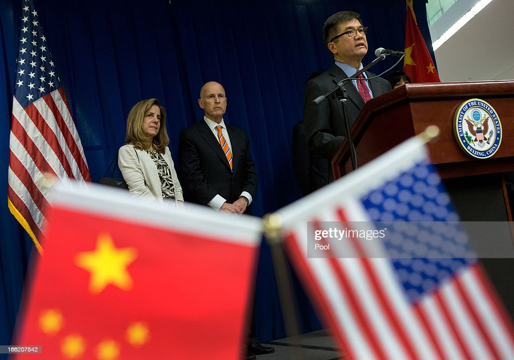 U.S. Ambassador to China <a gi-track='captionPersonalityLinkClicked' href=/galleries/search?phrase=Gary+Locke&family=editorial&specificpeople=1792234 ng-click='$event.stopPropagation()'>Gary Locke</a> (R) delivers his speech on stage as California Governor <a gi-track='captionPersonalityLinkClicked' href=/galleries/search?phrase=Jerry+Brown&family=editorial&specificpeople=217599 ng-click='$event.stopPropagation()'>Jerry Brown</a> (C) and the Govenor's wife Anne Brown (R) look on during a Trade and Investment reception at the U.S. Embassy on April 10, 2013 in Beijing, China. Brown is in China leading a business delegation and will meet with Chinese government and business leaders to discuss bilateral trade and investment opportunities between China and his state of California.