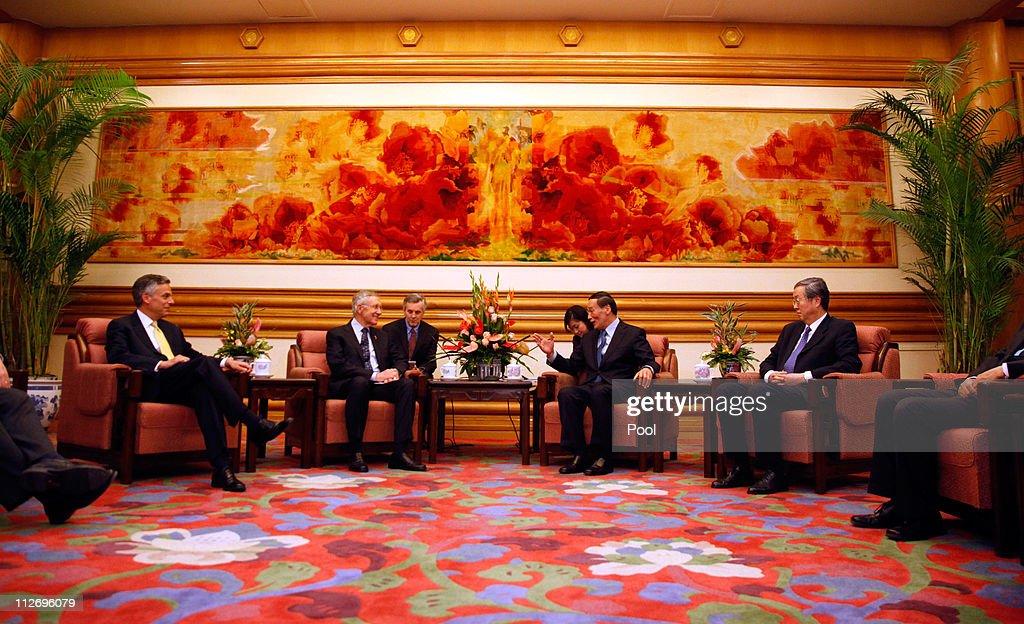 US Ambassador to China Jon Huntsman US Sen Harry Reid Chinese VicePremier Wang Qishan and People's Bank of China President Zhou Xiaochuan meet at the...