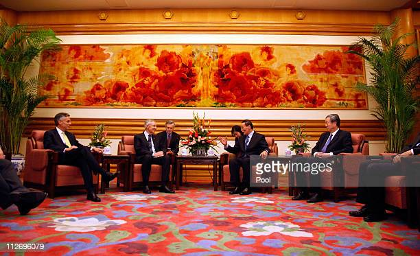 US Ambassador to China Jon Huntsman US Sen Harry Reid Chinese VicePremier Wang Qishan and People's Bank of China President Zhou Xiaochuan meet at the...