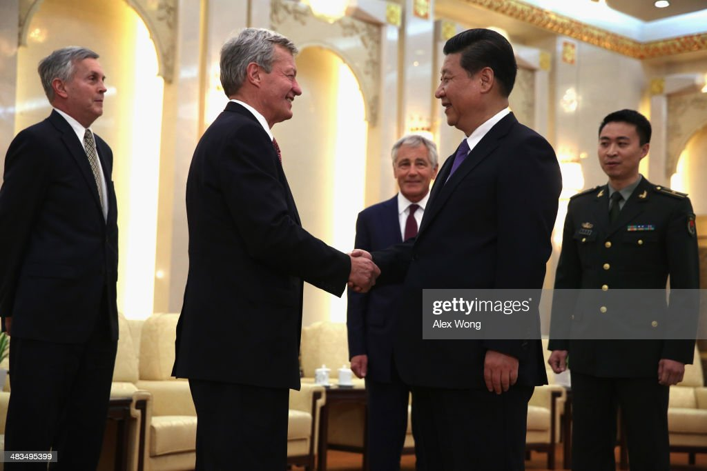 U.S. Ambassador to China <a gi-track='captionPersonalityLinkClicked' href=/galleries/search?phrase=Max+Baucus&family=editorial&specificpeople=242972 ng-click='$event.stopPropagation()'>Max Baucus</a> (2L) shakes hands with Chinese President <a gi-track='captionPersonalityLinkClicked' href=/galleries/search?phrase=Xi+Jinping&family=editorial&specificpeople=2598986 ng-click='$event.stopPropagation()'>Xi Jinping</a> (4L) as Secretary of Defense <a gi-track='captionPersonalityLinkClicked' href=/galleries/search?phrase=Chuck+Hagel&family=editorial&specificpeople=504963 ng-click='$event.stopPropagation()'>Chuck Hagel</a> (3L) looks on during a meeting at the Great Hall of the People April 9, 2014 in Beijing, China. Secretary Hagel is on the second stop of an Asian trip, the fourth time since he took office, to Japan, China and Mongolia.
