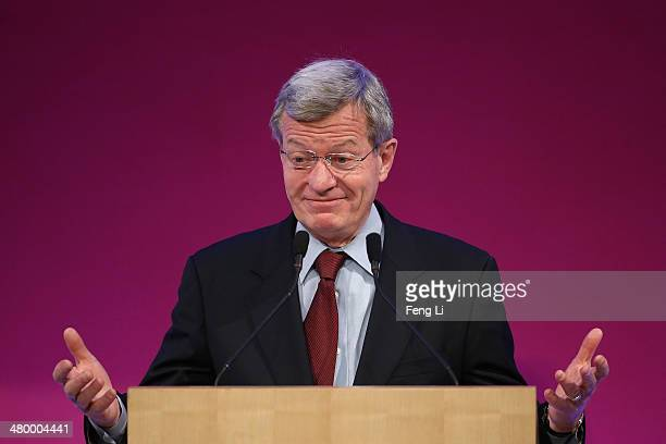 S Ambassador to China Max Baucus speaks before First Lady Michelle Obama delivers a speech at the Stanford Center at Peking University on March 22...