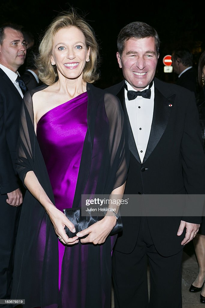 US Ambassador to France Charles H. Rivkin (R) and his wife Susan Tolson arrive at Les Beaux-Arts de Paris on October 8, 2013 in Paris, France. On this occasion Ralph Lauren celebrates the restoration project and patron sponsorship of L'Ecole des Beaux-Arts.