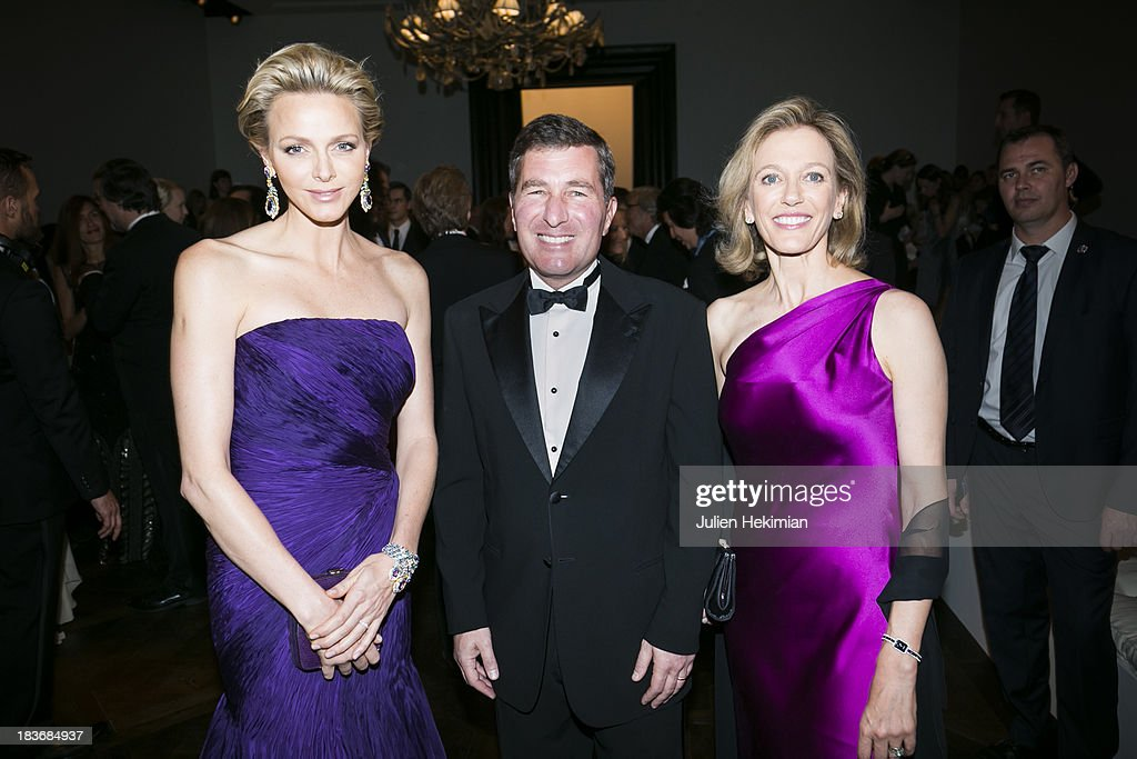 U.S. Ambassador to France Charles H. Rivkin (C), his wife Susan Tolson (R) and Princess Charlene of Monaco attend the presentation of the Ralph Lauren Fall 13 Collection Show at Les Beaux-Arts de Paris on October 8, 2013 in Paris, France. On this occasion Ralph Lauren celebrates the restoration project and patron sponsorship of L'Ecole des Beaux-Arts.