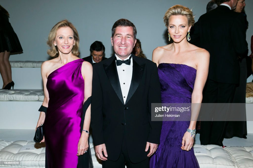 U.S. Ambassador to France Charles H. Rivkin (C), his wife Susan Tolson (L) and Princess Charlene of Monaco attend the presentation of the Ralph Lauren Fall 13 Collection Show at Les Beaux-Arts de Paris on October 8, 2013 in Paris, France. On this occasion Ralph Lauren celebrates the restoration project and patron sponsorship of L'Ecole des Beaux-Arts.