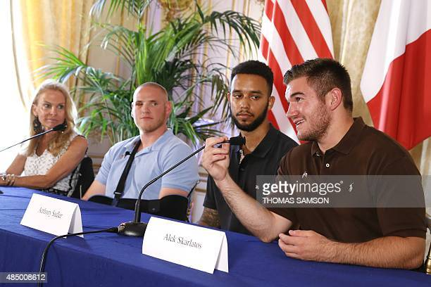 US ambassador to France Jane Hartley offduty US servicemen Spencer Stone and Anthony Sadler looks on as offduty US serviceman Alek Skarlatos speaks...