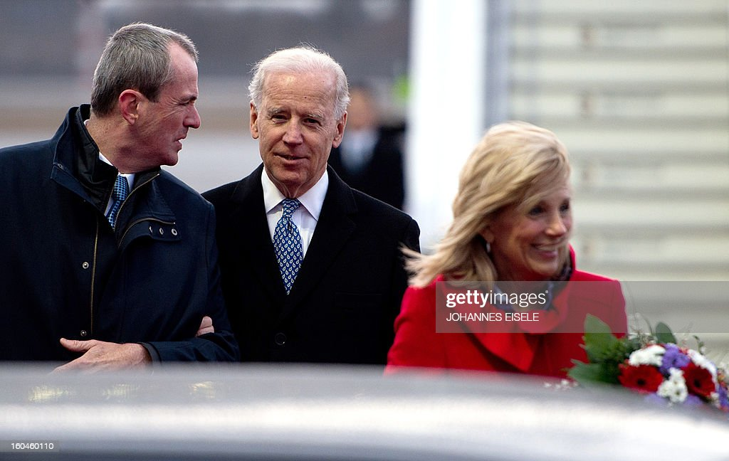 US Ambassador to Germany Philip D Murphy (L) welcomes US Vice President Joe Biden (C) and his wife Jill Biden upon arrival at the Tegel military airport in Berlin on February 1, 2013. Biden is to meet German Chancellor Angela Merkel for talks ahead of the Munich Security Conference. EISELE