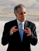 S Ambassador to Iraq Zalmay Khalilzad speaks to reporters after arriving at Suleimaniya international airport on August 3 330 kms north of Baghdad...
