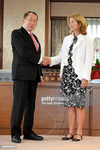 US Ambassador to Japan Caroline Kennedy and Japanese Justice Minister Katsutoshi Kaneda shake hand prior to their meeting at the Justice Ministry on...