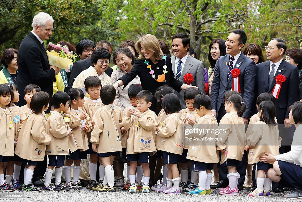 U.S. Ambassador to Japan Caroline Kennedy (C) is welcomed by local kindergarten children at Ise Jingu Shrine on April 16, 2014 in Ise, Mie, Japan.
