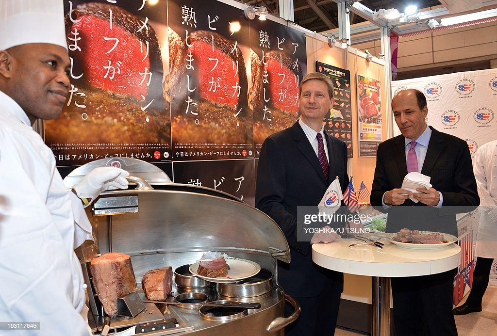 US Ambassador to Japan John Roos (R) and Gregory Hanes (C), assistant vice president of the US Meat Export Federation taste US beef at the annual 'Foodex' food exhibition in Chiba, suburban Tokyo on March 5, 2013. Japan has eased restrictions on beef imposed due to concerns over mad cow disease, easing a decade-long row between the allies. Japan, formerly the largest buyer of US beef, had agreed to allow the import of the meat from cattle slaughtered at up to 30 months old, higher than the earlier safety limit of 20 months. AFP PHOTO / Yoshikazu TSUNO