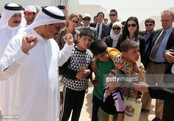 UAE Ambassador to Jordan Abdullah Nasser Al Ameri talks with Syrian refugee children as he tours the newly built UAE funded Mrigb alFuhud refugee...