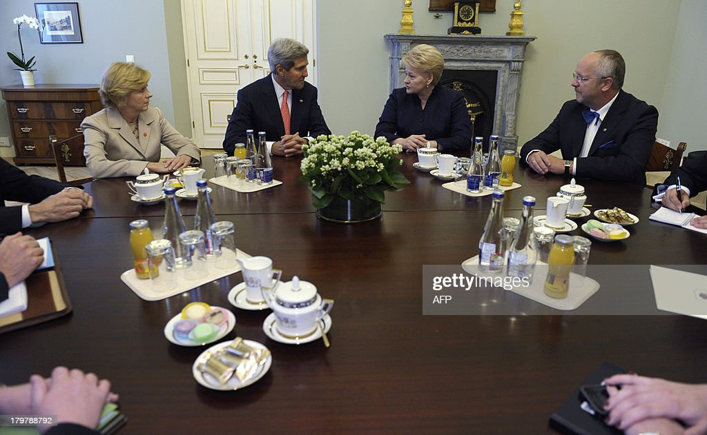 US Ambassador to Lithuania Deborah McCarthy (L), US Secretary of State John Kerry (2ndL), Lithuanian President Dalia Grybauskaite (2ndR) and Lithuanian Minister of National Defense Juozas Olekas (R) meet on September 7, 2013 at the Presidential Palace in Vilnius. Kerry sought to muster European Union support for military strikes against Syria, after a G20 summit failed to resolve bitter international divisions on the issue. Washington's top diplomat went into informal talks with the EU's 28 foreign ministers in Lithuania, which currently holds the EU's rotating chair, with the bloc itself sharply split on Syria and most nations highly reticent over military action.