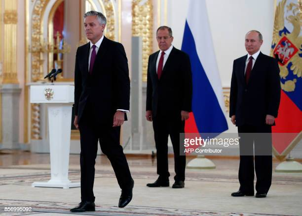 US ambassador to Russia Jon Huntsman walks after presenting his credentials to Russian President Vladimir Putin during a ceremony at the Kremlin in...