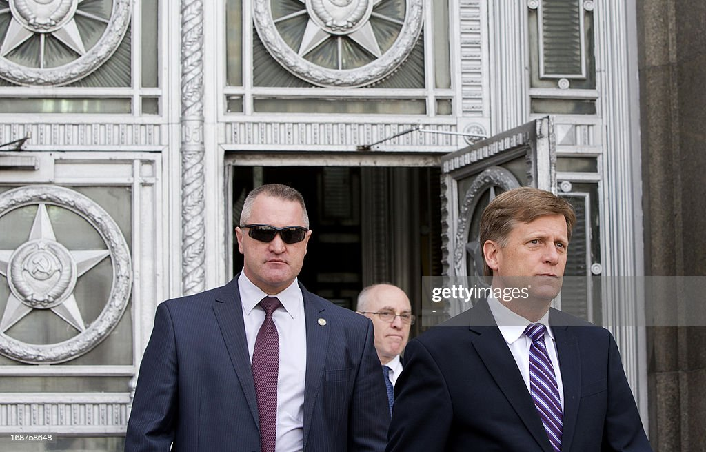 US Ambassador to Russia Michael McFaul (R) leaves the Russian Foreign Ministry headquarters in Moscow, May 15, 2013, after being summoned to explain the presence of an alleged CIA agent working undercover at the embassy who was detained this week. The ministry had summoned McFaul for an explanation after slamming Washington for what it described as 'provocative acts in the spirit of the Cold War'.