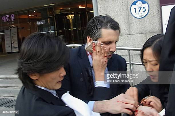 US Ambassador to South Korea Mark Lippert is seen injured on March 5 2015 in Seoul South Korea Ambassador Lippert was attacked with a razor blade by...
